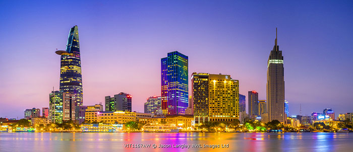 Central Ho Chi Minh City (Saigon) skyline and Saigon River at dusk, Vietnam